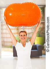 middle aged woman exercise ball