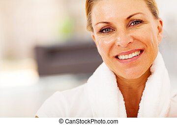 fit middle aged woman closeup portrait with towel on her...