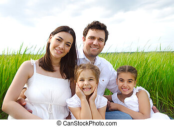 Happy young family with children outdoors