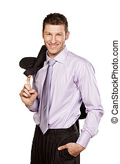 smiling handsome businessman in a shirt with a jacket over...