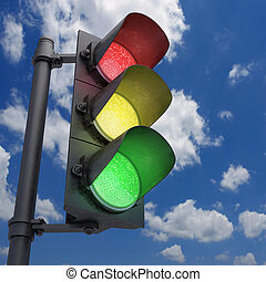 Traffic Light in a blue sky with all the lights on.