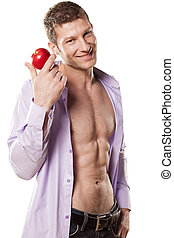 red apple and handsome man - handsome athletic man with a...