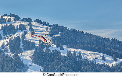 Helicopter - A helicopter flying in Swiss mountain