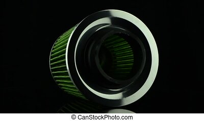 Air cone filter rotating on black background Vehicle...
