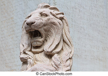 Stone lion - A stone lion sculpture in front of a memorial...