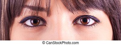 Close up of beautiful caucasian woman eyes with makeup