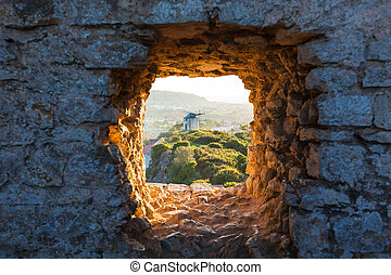 Old Windmill through Window in Fortress Wall - Old Windmill...