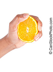 African American hand squeezing an orange slice,over grey...