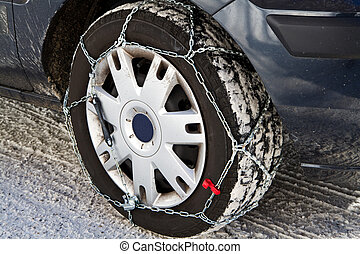 snow chains - a Car with snow chains