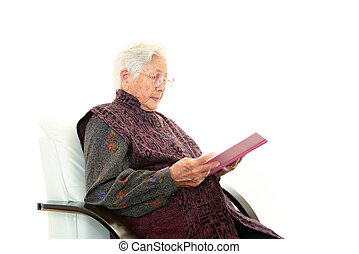 Relaxed old woman - Old woman reading her book
