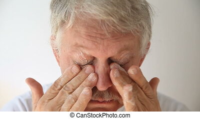 man soaping eye area - senior man cleans his eyelashes and...