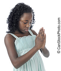 Prayerful - Closeup image of a beautiful young tween with...