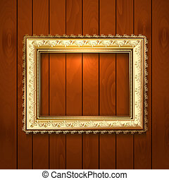 Vintage gold frame on a wooden texture
