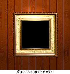 Golden vintage frame on wooden texture