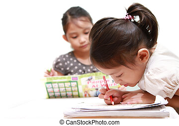 Kids Enjoy Reading & Colouring - Female kids patiently doing...