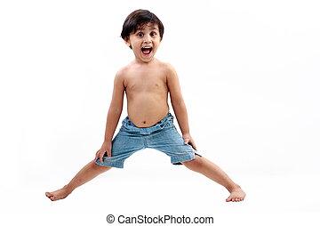 Playful male kid spreading legs - Male kid wearing blue...