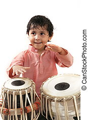 Indian male child playing tabla - Indian male child training...
