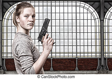 Girl with gun - Young girl with a handgun