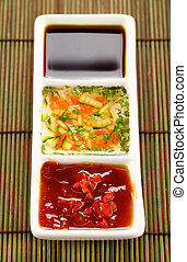 Asian Condiments - Asian dipping sauces consisting of...