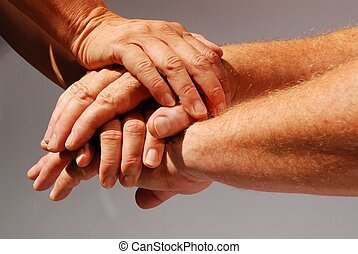 hands symbolizing community - four hands symbolizing...