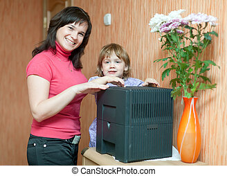Woman and child uses humidifier - Woman and child uses...