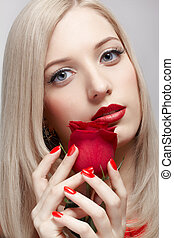 blonde woman with rose - portrait of young beautiful blonde...