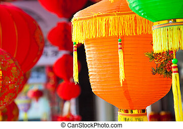 Colorful Chinese paper lanterns hanging in a street martket