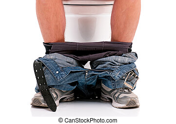 Man on toilet bowl - Man is sitting on the toilet bowl, on...