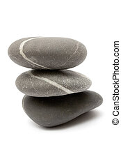 Stacked Stones - Three gray stones stacked on each other....
