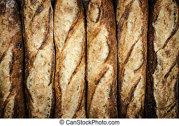 Baguettes - Fresh artisan baguette bread loaves in a row