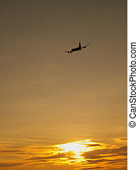 Plane at sundown - Sunset with clouds and aircraft in sky