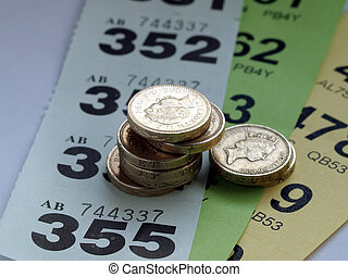 Gambling - Lotto or raffle tickets with pile of coins