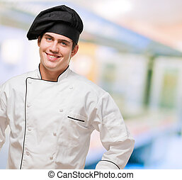 Portrait Of A Young Chef With Hand On Hip