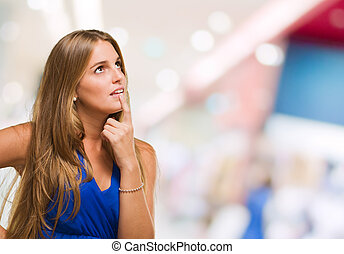 Portrait Of A Young Woman Thinking at a mall