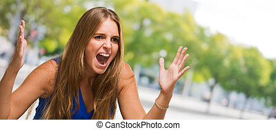 Portrait Of A Young Woman Yelling, outdoor