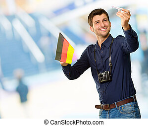 Photographer Holding German Flag And Miniature Airplane,...