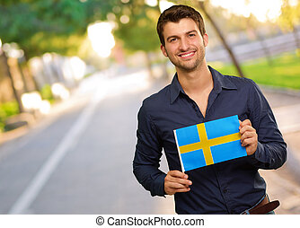 Young Happy Man Holding Sweden Flag, Outdoor