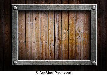 Metal frame - A metal frame on a wooden background