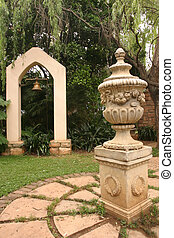 Statue in a garden - A statue is situated i the middle of a...