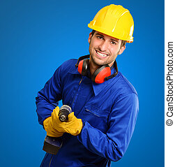 Engineer Holding Drill Machine On Blue Background