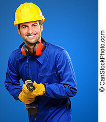 Happy Engineer With Drill Machine Isolated On Blue...