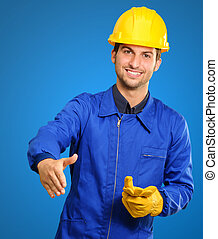 Young Engineer Offering Handshake Isolated On Blue...