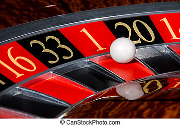 Classic casino roulette wheel with red sector one 1 and...