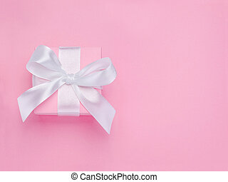 Pink Valentines Day gift box tied white satin ribbon bow