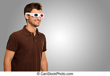 Happy Young Man Wearing 3d Glasses Isolated On Grey...