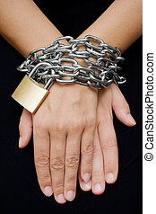 Bound Hands - Female hands bound with chain and padlock...