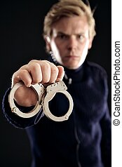 Cop with Handcuffs for Law Offenders - Cop showing handcuffs...