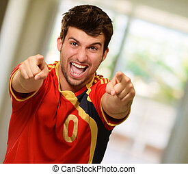Portrait Of Excited Sportsman Pointing With Hand - Portrait...