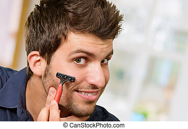 Man Shaving His Beard, Indoors
