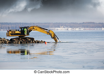 giant bulldozer dredging in the sea - bulldozer dredging and...